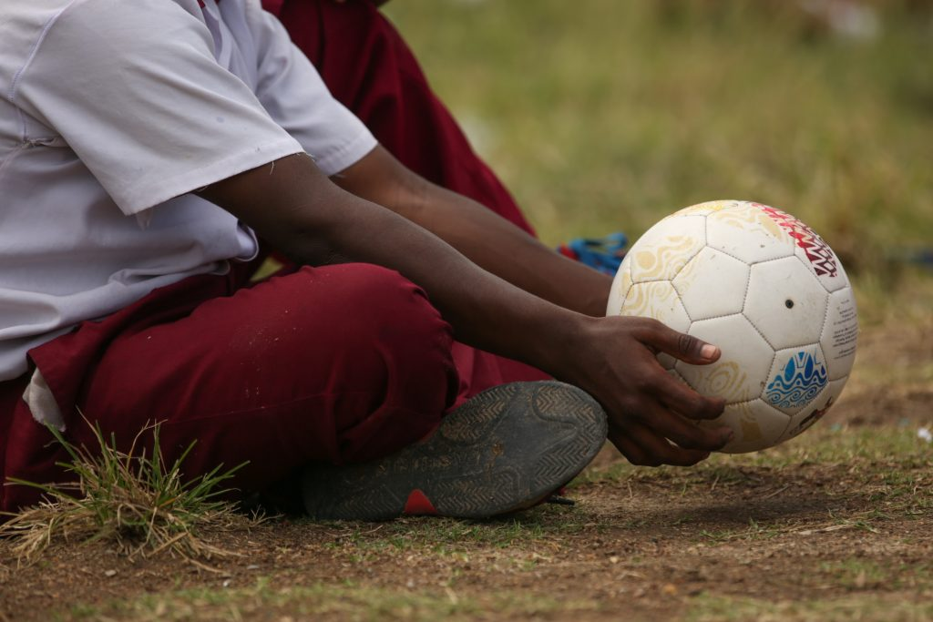 PNG boy holding soccer ball
